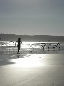 girl running down the beach