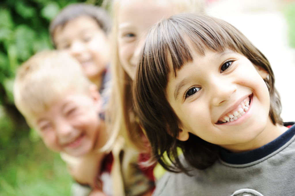 Autism Therapies Blur Boundary Between >> Smiling Kid In Foreground With Blurred Others In Background Ahss