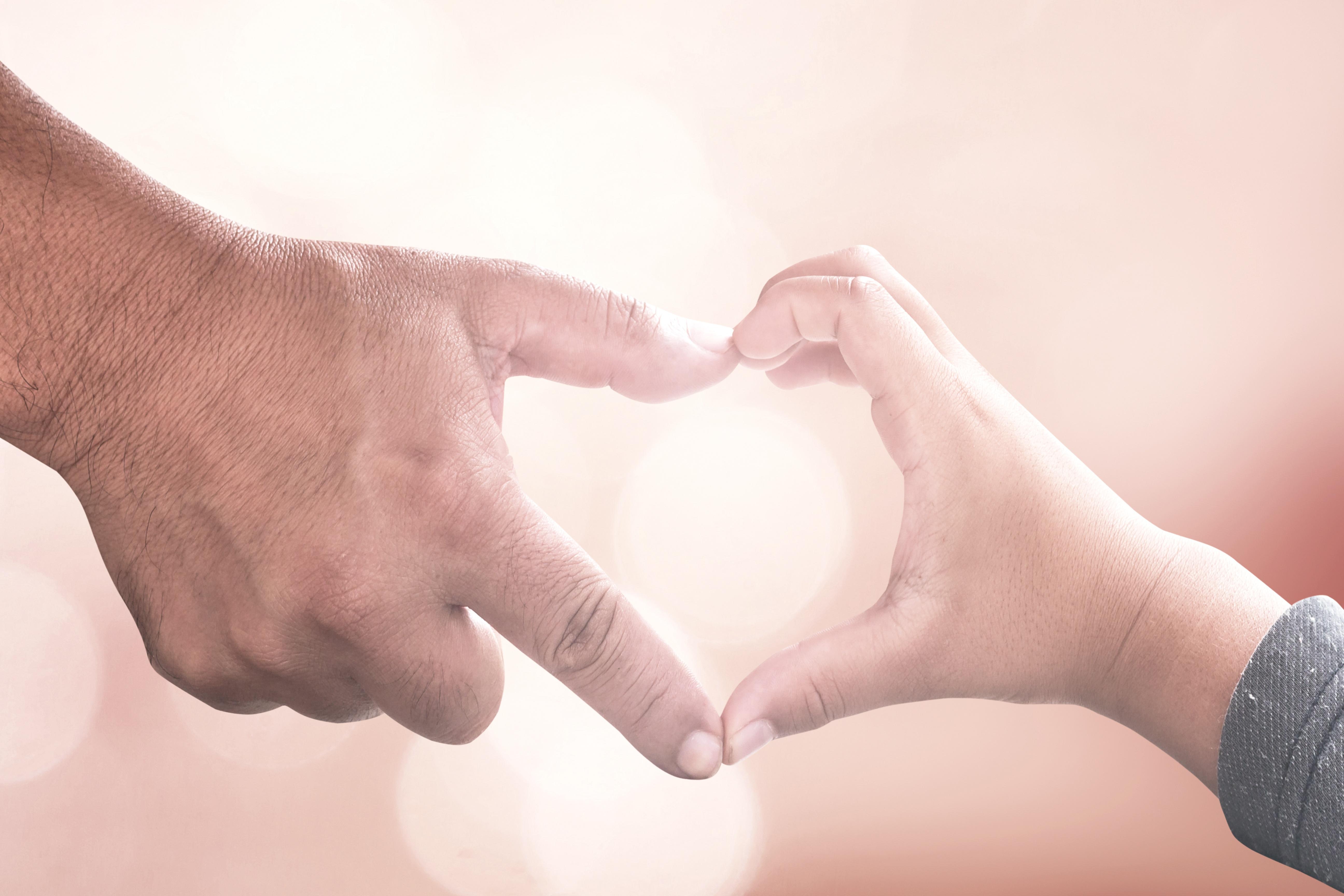 hands make heart parent and child.jpg