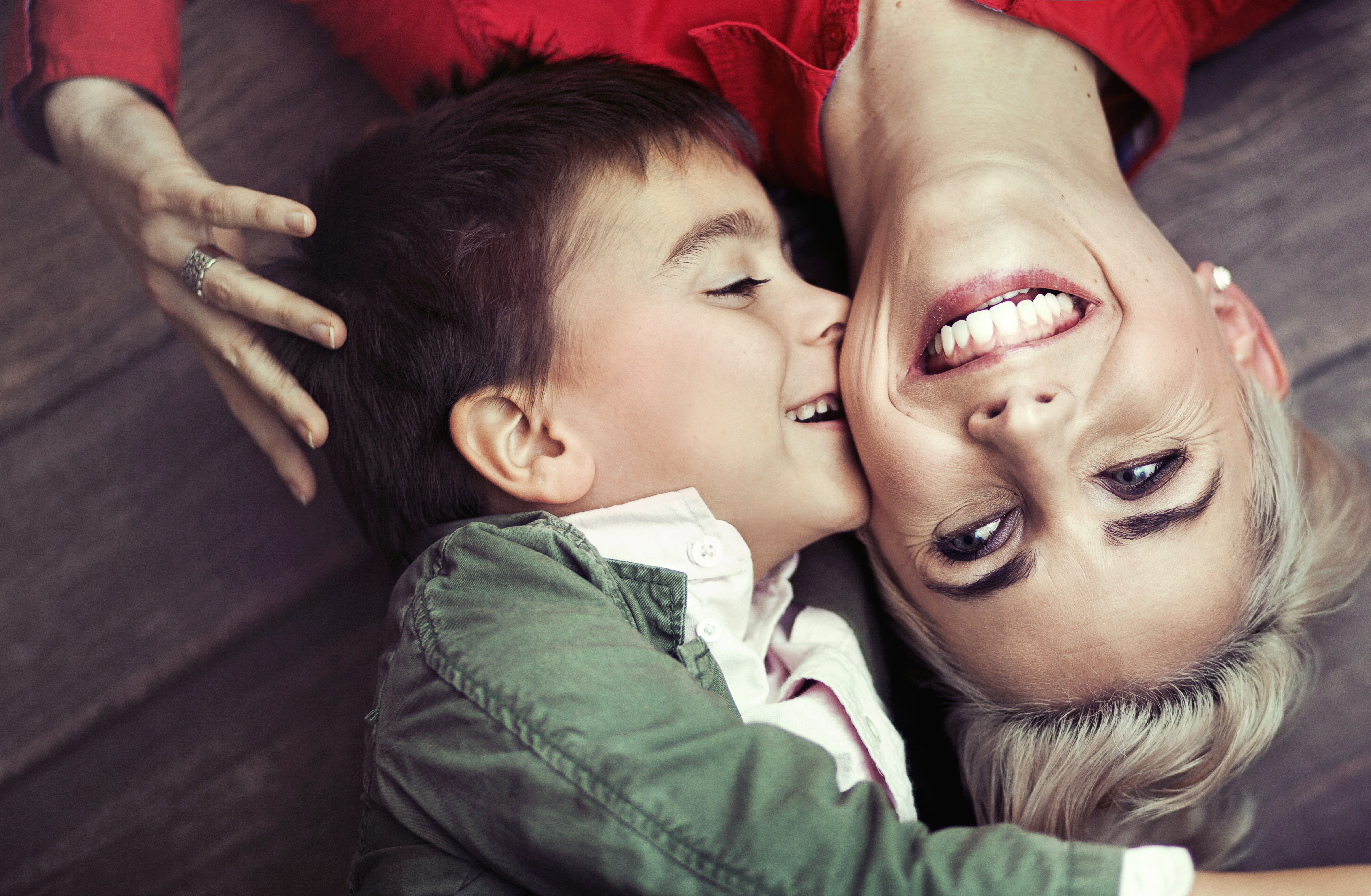 young boy kissing his mom.jpg